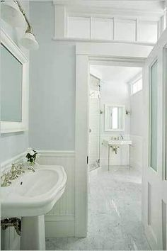 ~ another pretty bathroom...pale aqua blue walls, little paned window over door, pedestal sink, breadboard