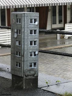 Miniature architectural pasting by Berlin based street artist EVOL