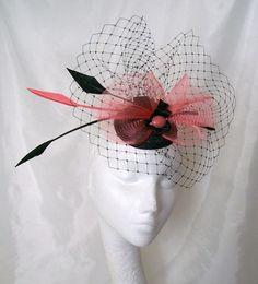 Coral Watermelon & Black Arrow Feather Merry Widow Veil & Crinoline Sinamay Fascinator Mini Hat. $ 58, via Etsy.