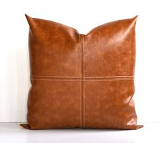 Introducing our newest faux-leather pillow! Here it is with beautiful paneling, a fabulous decorative top-stitch and a contrasting back of your choice. Sofa Pillows, Floor Pillows, Leather Pillow, Leather Cushions, Funny Pillows, Caramel Color, How To Make Pillows, Leather Projects, Animal Pillows