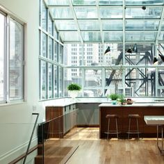 Love everything about this | Kitchen in greenhouse with views of New York via Remodelista