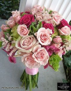 Love this look! Bells of Ireland, light and dark pink roses and some pale pink filler flower.