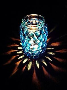 This looks beautiful! JS Idea: Smooth jar (pickle jar?), glass marbles with one flat side (dollar store), E6000 glue, small votive or flame less candle.