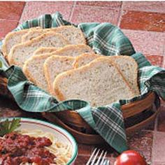 """Four-Herb Bread Recipe  Marjoram, thyme, basil and chives season this moist loaf, submitted by Sue Murphy of Greenwood, Michigan. """"A friend gave me this recipe,"""" she says. """"The aroma while it's baking will make you think of a stuffed turkey roasting in the oven."""""""
