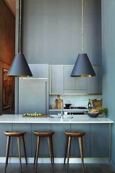 Stunning blue kitchen with blue walls and blue refrigerator that blends seamlessly into walls. ...