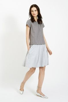 Hand woven grey top in 100% cotton. Textured dobby weave pattern with short sleeves. Length 59cm.