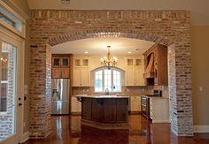 Custom Home Build Gallery of the interior of a home on Barras Rd in Lafayette, LA Archways In Homes, Small Kitchen Makeovers, Brick Archway, Exterior Wall Design, Living Room Decor Fireplace, Mexican Kitchen Decor, Southwestern Home, Rustic Kitchen Design, Spanish House