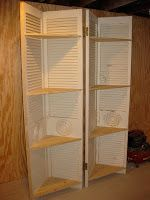 RePurpose: 4 louvered closet doors into corner shelves. Add some shelves and paint.