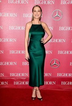 Brie Larson cut a sleek figure in her silky emerald gown. The Room actress paired her slip-like dress with strappy peep toe heels and delicate jewelry for an effortlessly chic look.