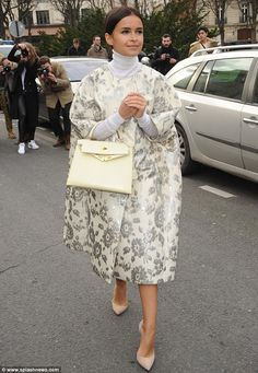 Style queen: Harper's Bazaar Russia editor Miroslava Duma wore a giant overcoat and carried a vintage style handbag to the PFW show