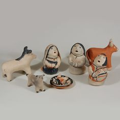#adobegallery - Cochiti Pueblo 8-piece Nacimiento Set by Josephine Arquero (1928-present) - Josephine Arquero is the daughter of Damacia Cordero and was taught the art of pottery figurine construction by her mother. Josephine's figurines do not resemble those of her mother's, but have a character of their own. She is now 85 years of age and is still making pottery to the best of our knowledge.