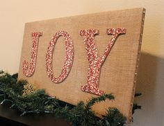 Becoming Martha: {5+5 Fridays} Great Christmas Crafts for a Group Dollar store canvas, thumb tacks for the sides, get burlap and letters on sale.