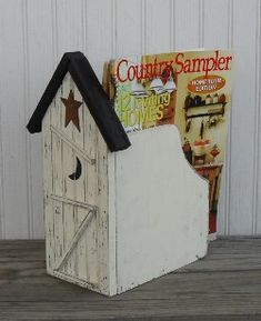Outhouse Magazine Rack..  Bet you could just buy a wooden magazine holder from Hobby Lobby & attach or make the outhouse piece to it.
