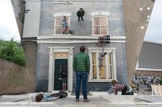 Topsy-Turvy Terrace: Fun Times at the Barbican's Dalston House   Ever wanted to scale the wall of a late Victorian terraced house?  The project was commissioned to coincide with the 2013 London Festival of Architecture and in association with OTO Projects. The creator of this grand illusion is the artist Leandro Erlich, whose work incorporates audience interaction and the distortion or subversion of spatial reality.