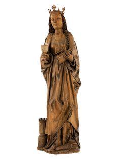 Höhe: 31 cm. Mainfranken, Ende 15. Jahrhundert. Im Kontrapost auf mitgeschnitztem Sockel stehend, daneben ein vom Sockel hochziehender Turm als Attribut. Die...