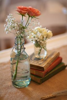 Sweet simple centerpiece. I like that its not too rustic but still has the rustic charm.