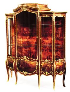"FRANÇOIS LINKE (1855-1946) A Very Fine and Large French Louis XV Style Gilt-Bronze Mounted Kingwood and Vernis Martin Decorated Vitrine with a three-part Brèche d'Alep marble tops, the lock has been removed to reveal the stamp Ct. LINKE/PARIS. Linke's Index Number 76 ""Grande vitrine Louis XV 3 corps bois de violette Panneaux Vernis Martin"". Circa: Paris, 1901-1914"