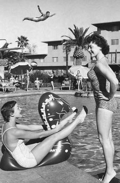 Love the fun vintage poses, pool play and retro floatie in this photo. Las Vegas, Nevada 1955