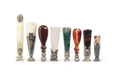 EIGHT SILVER OR PLATED MOUNTED DESK SEALS  SECOND HALF 19TH CENTURY  Comprising two mother-of-pearl handled seals, and assorted seals with agate, moss-agate, stained agate and rose-quartz handles