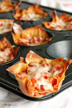 Pepperoni Pizza Cupcakes: pepperoni, cheese, and pizza sauce baked inside of crisp wonton wrappers: the ultimate handheld pizza! Only 4 main ingredients and 20 minutes! Perfect as an appetizer or a quick lunch. www.thereciperebel.com