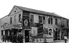 "The ""Fatal Corner"" of the where Commerce and Soledad streets now intersect on Main Plaza, included Hart's Cigar Store, which had upstairs gambling rooms connected to the adjacent Vaudeville Theater, site of a famous 1884 shooting. Old Pictures, Old Photos, Random Pictures, Old West Town, Western Photo, Texas History, Wild West, Wyoming, San Antonio"