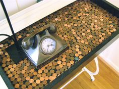 Junky Vagabond made a table top in pennies on top of an old sewing machine base. So unique! She shows how she did in her post.