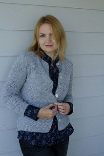 Cardigan with alternating bands of stockinette and double moss stitch, and contrasting color trim.