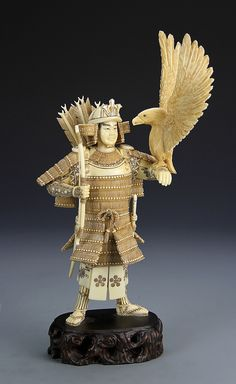 Description: Japan, 19th C., carved ivory warrior, expertly carved in standing figure, with eagle resting on arm, with Meiji mark on base. Height 7 in.