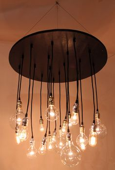 The Neely Round Industrial Chandelier with vintage bulbs. $675.00, via Etsy.