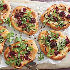 At happy hour, pair these appetizer-size pizzas with a chilly glass of rosé. For an entrée, simply roll dough into larger rounds.