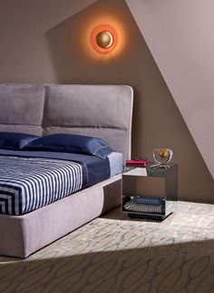 'Laze' bed, from £5,388, by Rodolfo Dordoni, for Poliform. 'Nervures' duvet cover set, £379; 'Chequered Plaid' comforter, £629, both by La Perla Home Collection, from Fazzini. 'Lederam W1' wall sconce, £400, by Catellani & Smith, from The Conran Shop. 'Elliott' side table, £4,509, by Rodolfo Dordoni, for Minotti. 'Lippiatt' A5 writing folder, £450, by Smythson. Glasses, $499, by Lindberg. 'Lamy 2000' fountain pen, £250, by Lamy. Magnifying glass, £720, by Carl Auböck, from Sigmar