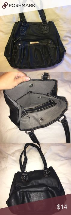 Black Rossetti shoulder bag Black shoulder bag still in really good condition. I got a lot of use out of this bag but there is no damage. The purse has a double snap closure and a lot of pockets for storage and organization! Rosetti Bags Shoulder Bags