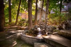 This home has been tastefully integrated into nature via an outstanding landscape plan, the curb appeal emanates a Zen like luxury Beautiful Architecture, Water Features, Curb Appeal, Luxury Homes, Fountain, Exterior, Landscape, Garden Water, Outdoor Decor