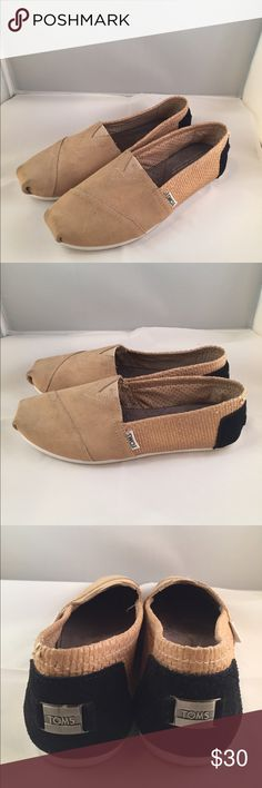 Tom's Classic Suede Slip-ons Women's size 7 Tom's Classic Suede Slip-ons, tan with black back. Women's size 7.  Worn once. TOMS Shoes Espadrilles
