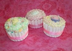 Cupcakes made from burp cloths, onesies, socks, and wash cloths. A perfect gift for the many baby showers I have coming up!