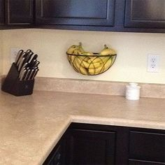 why didn't I think of this?? hanging planter basket re-purposed as a fruit holder! Frees up valuable counter space