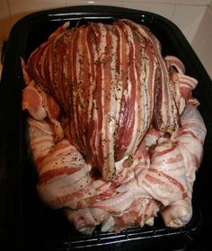 A chicken stuffed in a duck stuffed in a turkey. Every layer is wrapped in bacon. Looks like a heart attack waiting to happen, but geez I wish I could make this.