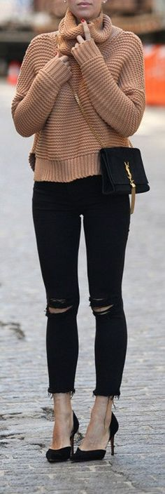 Helena Glazer wears a pair of distressed black jeans with a knitted camel pullover.