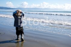 Child looks out to the Sea in Winter Sun royalty-free stock photo