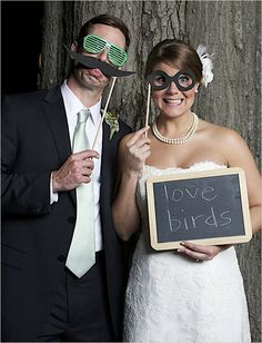 Photo booth with tickle trunk and message board- awesome wedding reception idea!