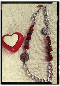 Collana realizzata con ambra e metallo argentato. By NiNa