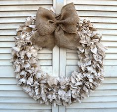 A rustic wreath for your home or wedding. This item is made with hand tied strips of burlap and a faux linen fabric. Each 2 inch piece of fabric