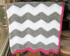 CHEVRON BABY BLANKET : white and grey chevron crochet baby blanket with raspberry pink edge. $50.00, via Etsy.
