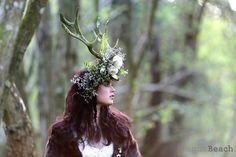 Styled Photoshoot set in a enchanting Sussex bluebell wood using a custom made antler bridal headpiece and a moss covered chair. The final images are strong and magical giving an almost fairytale feel. CREDITS Danni Beach Photography Flowerbug Designs,  & Mathilda Rose Bridal Boutique  #antler #bride #floralcrown #inspiration #woodland #bluebells #sussex #rustic #lace #johannahehir #blush #ivory #mosschair #fairytale #magical #romantic #stag #bouquet #wedding #bridal #styledshoot