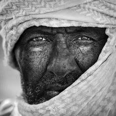This man is a camel jockey waiting for the race. Taken beside the shade of the…
