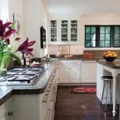 Honed granite in soft gray-green tones tops the kitchen counters and the 5-foot-square custom island.