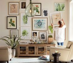 Would you like to learn how to create a beautiful gallery wall that will beautifully complement your home decor? This article covers how you can create the perfect gallery wall. Click through to learn how to hang a gallery wall that will beautifully compl Home Interior, Interior Design Living Room, Living Room Decor, Interior Livingroom, Reclaimed Wood Media Console, Gallery Wall Layout, Gallery Walls, Eclectic Gallery Wall, Inspiration Wall