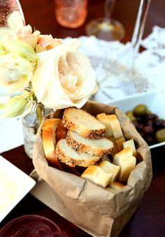 Brown paper bag bread basket- inexpensive super cute and very chic! Try it!