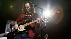 Geddy doing what Geddy does best.