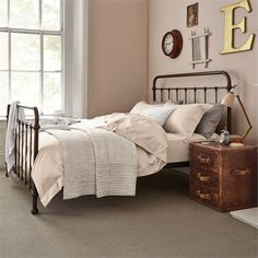 Traditional iron beds capture the essence of vintage chic #featherandblack